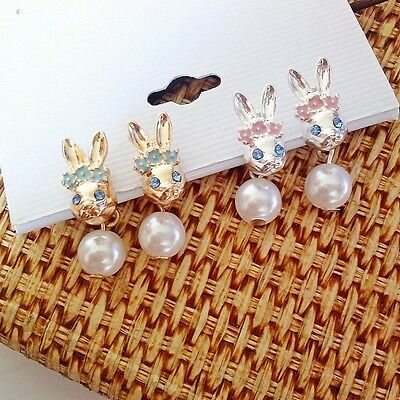Crystal eyed bunny rabbit stud earrings, a pearl hanging from the earring back (Bunny Rabbit Hanging)