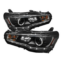 REDUCED!!! Brand New In Box Mitsubishi Lancer Spyder Headlights