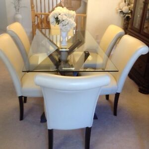 Tempered glass dining table and 6 ivory leather chairs