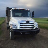 Rent a front-load dumpster in Calgary.