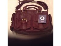 Lovely brand new handbag with many useful pockets.