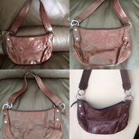 Brown leather embossed purse.