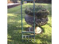 Garden grass aerator - used for making holes in grass to improve quality