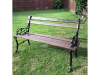 Vintage bench with good strong wood and cast iron bench ends