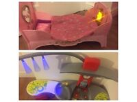 Play kitchen with lights and baby doll bed with bedding