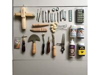 Leatherworking tools with dyes, glue, lacemaker, stamp, etc