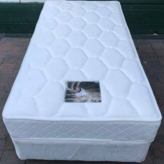 Excellent white single bed base with mattress. Delivery available