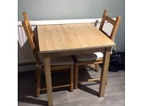 IKEA Small kitchen/dining room table and two chairs. Only 1 set remaining