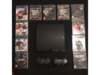 PS3 Slim, 2 controllers and 11 Games