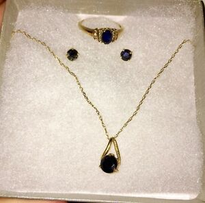 Sapphire earring/necklace/ring set in yellow gold