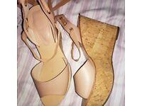Brand new Wedged Heels. Never been worn