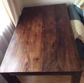 Solid mango wood table.