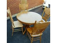 Pine round dining table and 4 chairs