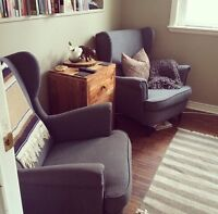 Two IKEA wingback upholstered chairs