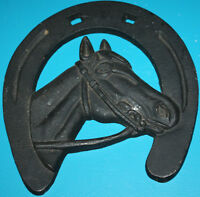 CAST IRON HORSE SHOE WITH HORSE HEAD
