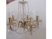 2 lovely crystal 5 arm chandelier lights slightly different £35 each