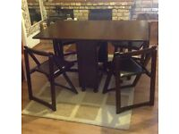 Space saving butterfly folding table and 4 chairs.