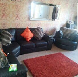 Corner sofa and round swivel chair