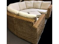 Wicker five piece set two settees two chairs and stool.