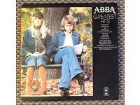 Three vintage vinyl LP records. ABBA! The Jacksons, Sister Sledge