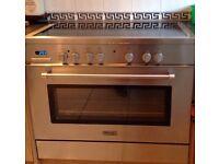 Kitchen cooker ( De Longhi), fridge and freezer
