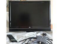 LG Flat Screen TV + Remote + Wall Mounting 53 x 39 cm
