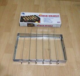 NEW BARBECUE CRADLE/STAND WITH 7 SKEWERS, £10
