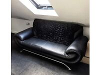 Black leather settee with silver legs
