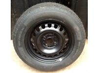 Steel wheel and new tyre