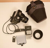 Canon t1i + EFs 18-55mm IS + battery grip + acces + cours 30min