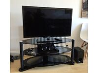 Samsung 40'' LED Smart TV, Panasonic blue ray player with surround sound and black glass to stand.