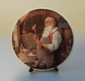 "COLLECTOR PLATE BY NORMAN ROCKWELL ""SANTA IN HIS WORKSHOP"""