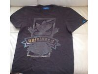 Adidas men's or boys T-shirt age 13. - 15 Would say Size small to medium