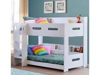 White wooden bunkbeds, glow in dark steps, book / toy shelf. As new condition.