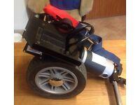 Powerstroll wheelchair aid