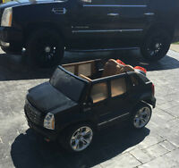 Power Wheels Cadillac Escalade driving toy truck