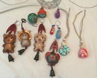 For sale are 9 asian keychains and 2 perfurm decoratives.   Pic