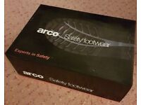 Arco black safety boots.