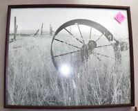 Wagon Wheel in a field Framed Photo