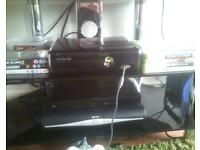 xbox 360 with games and two pads.SWAP