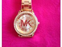 Wow. Brand new MK rose gold watch