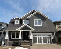 CONSIDER This Stunning Custom Home in Luxurious Garden Heights