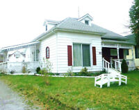 TWO HOUSES ON ONE LOT- GREAT INCOME POTENTIAL!