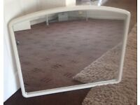 Giant white arched mirror