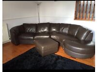 6 seater curved brown leather sofa & foot stool with storage