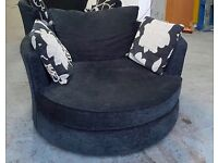 DFS Black Swivel Cuddle/Love Armchair (2 Available).WE DELIVER