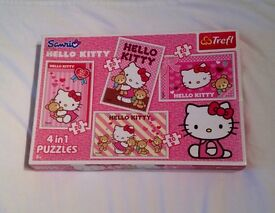 HELLO KITTY 4 IN 1 TWENTY PIECE JIGSAW PUZZLES. COMPLETE AND VGC.