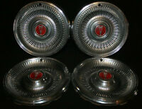 2 sets of 4 Vintage / Antique Car Hubcaps