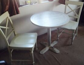 2 chairs (IKEA) and round white painted table