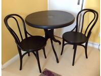 Plastic round table and 2 chairs